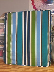 Striped cushion with piping