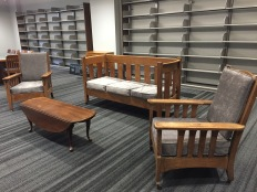 Upholstered library cushions on antiquated wood frames