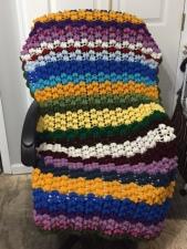 Popcorn stitch crochet lap blanket